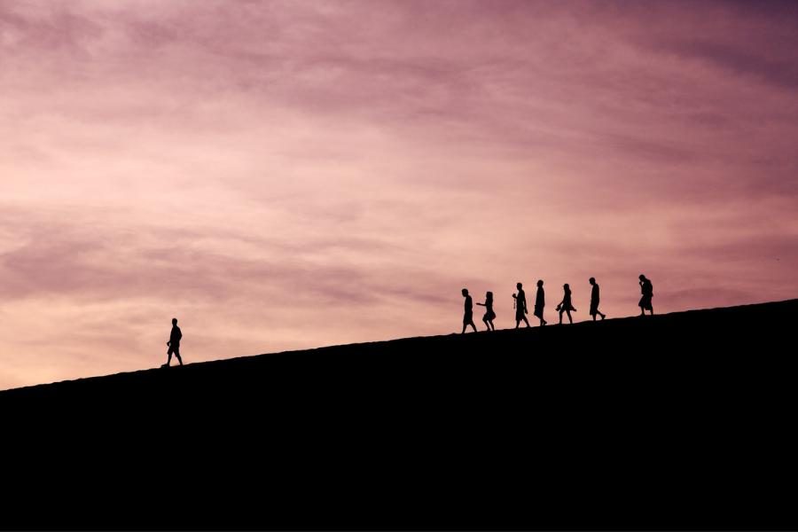 Effective Leadership Man Leading Group On Mountain